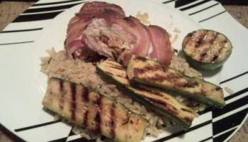 Chicken Stuffed With Feta, Sun Dried Tomatoes And Coriander, Wrapped In Bacon