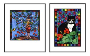 """Lino prints in black frames: """"Thriving"""" (woman combined with a plum tree) and """"Black and White Cat in the Garden"""". Both lino prints have rainbow borders."""