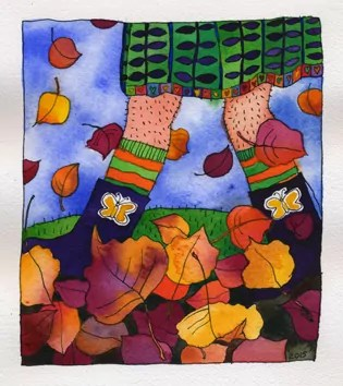 legs wearing boots kicking up autumn leaves