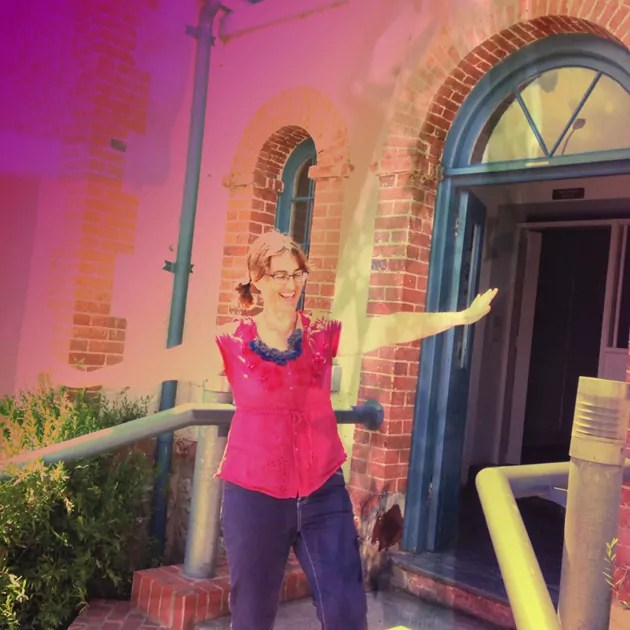 tangerine Meg on the steps of the old Goolwa Police Station; rosy filter on the photo