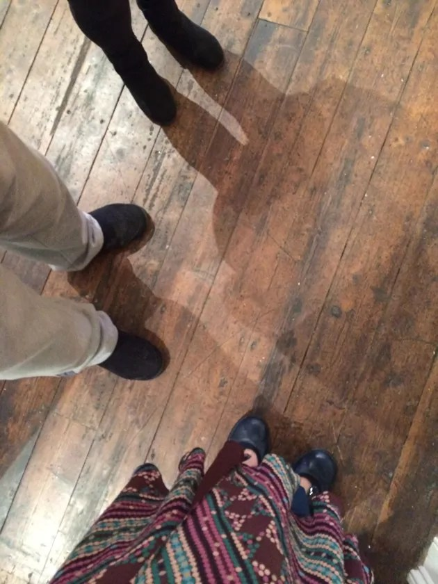 photo of feet at an exhibition launch