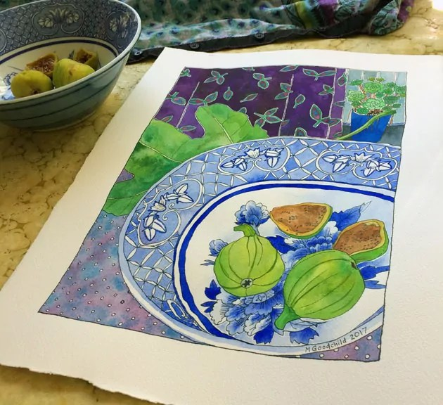 """Angled shot of """"Early Figs in Blue and White Bowl"""" painting laid on a swrily yellow-ish table surface, with actual bowl and figs towards the back and to the left."""