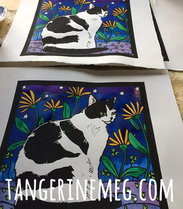 black and white cat lino prints drying