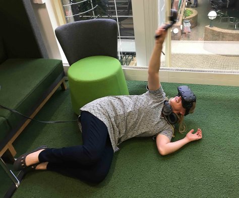 Artist Heidi Hinder immersing herself in a virtual reality experience