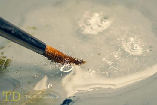 Saliva for brush care and maintenance