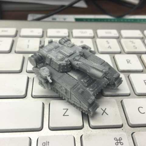3D printed miniature tank for 40k epic size 10mm scale - Arenpi 3D printable files and marketplace for 3D printing miniatures and models - shadowsword tank printed and on keyboard
