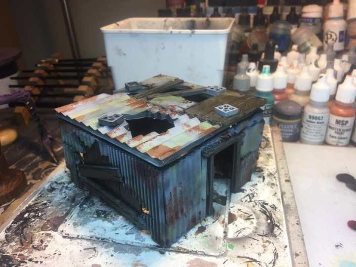3 Awesome Ways to Make Wargaming Terrain (Cheap, Easy, and Free) - low cost cheap DIY wargaming terrain for Warhammer 40k, Age of Sigmar, and other tabletop games, DND terrain making, dungeon and dragon terrain for RPG - 3d printed shack and painted