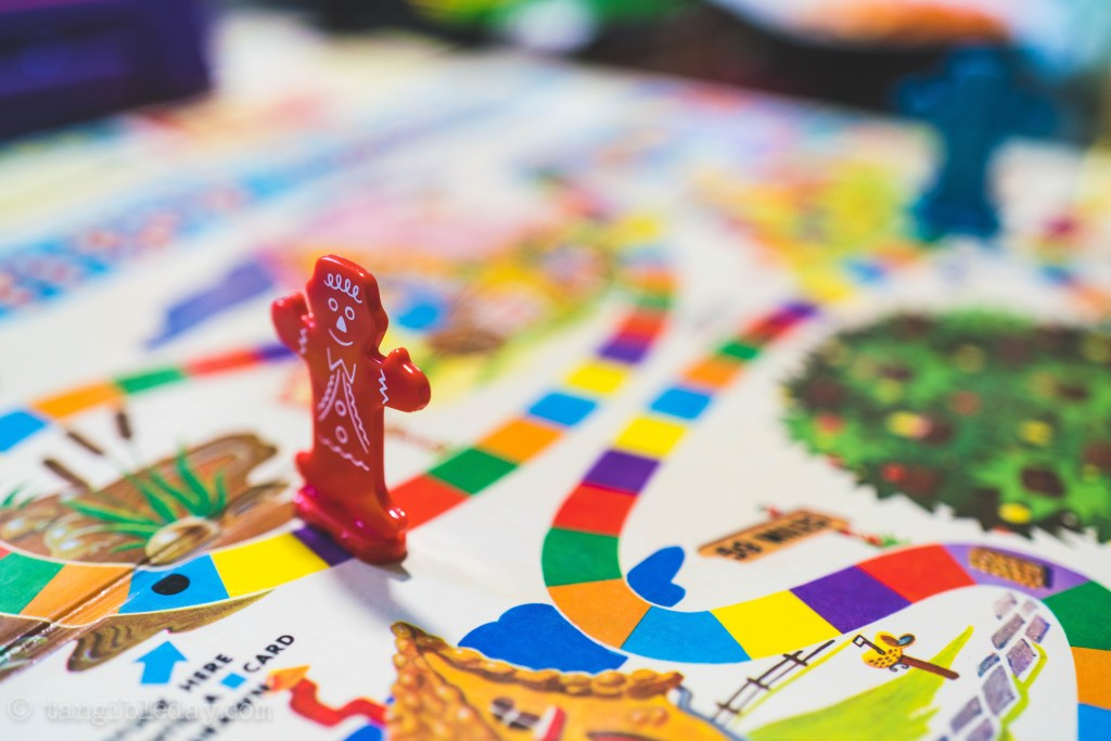 "Is Candy Land the ""Reality"" Game? - deconstructing candy land. Candy land the adult game for kids at heart - red playing marker on linear space"