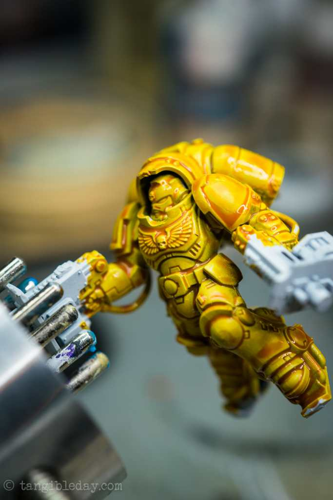 How to Paint Yellow Space Marines (Easy and Fast) - how to paint yellow models and miniatures - citadel contrast yellow paint drying and darkened recesses close up