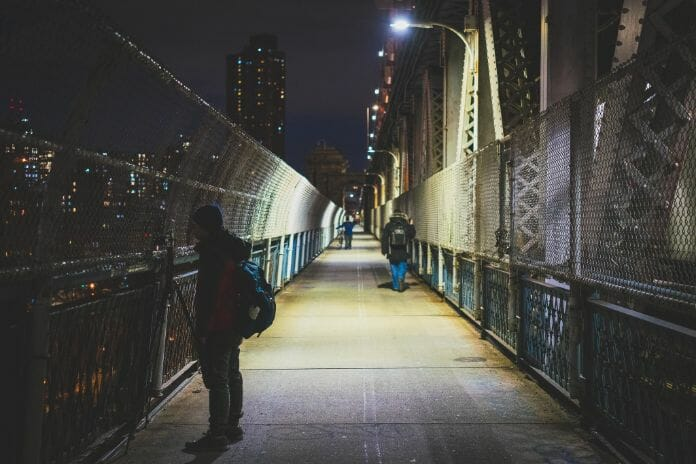 Night photography - night time photography and how to take pictures at night - Night light photography and how to take pictures at night - what night photography settings - photographer standing on bridge to capture night time pics