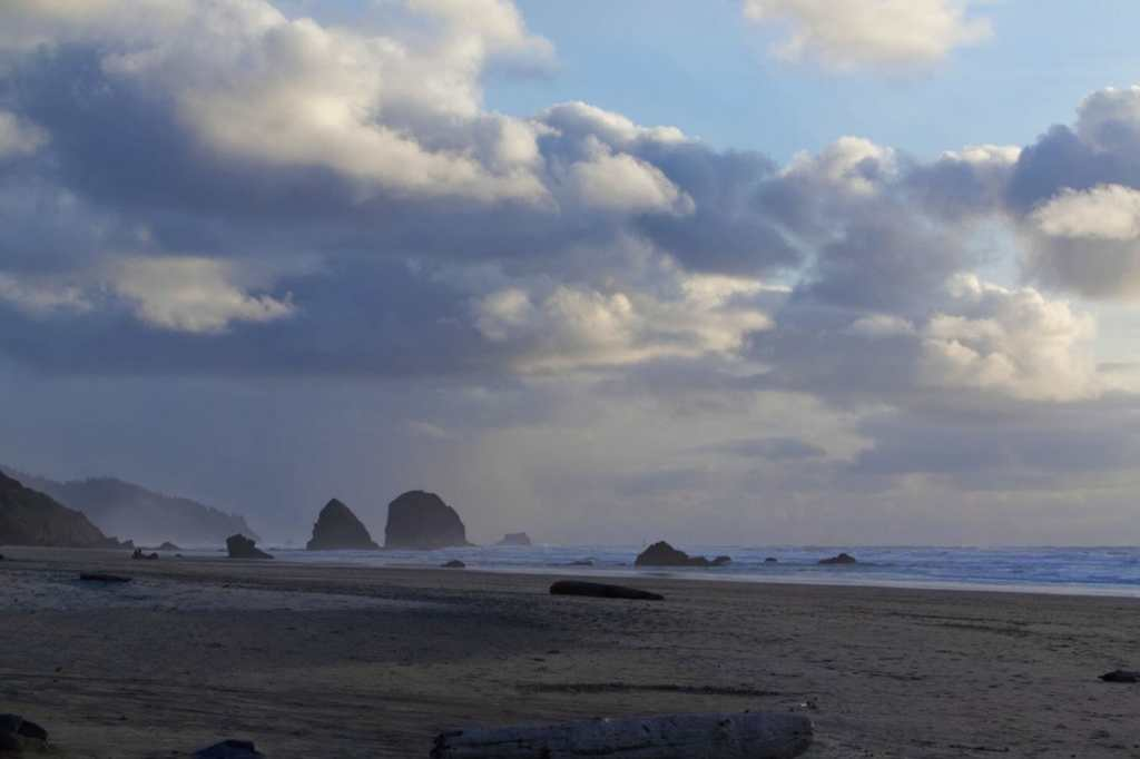 Bad weather photography ideas - landscape photography in bad weather -landscape photos in the rainy weather - landscape photography in the rain - rain photography ideas - overcast landscape photography - how to take better photos in bad weather - picture of Cannon beach in Oregon