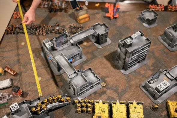 Is Warhammer 40K Worth It? Why You Need to Play Warhammer 40k - Is Warhammer 40k expensive? - Should I start playing warhammer 40000 - why you should play WH40k - rules and tape measure for playing