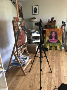 Camera set up to take photos of a painting