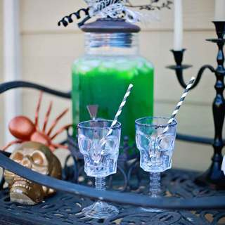 Sweet and Sour combine in the perfect marriage of flavors in this sparkling sour apple drink with a popping candy rim and fun creepy crawler garnish!