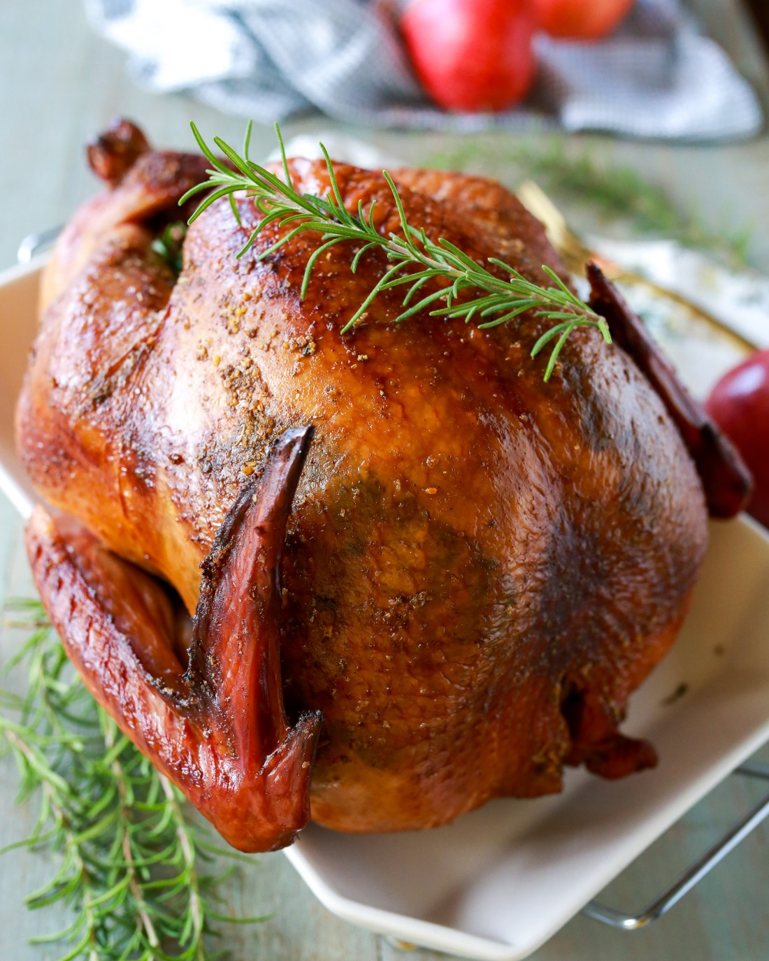 The perfect turkey recipe: smoked turkey loaded with flavor, with a crispy golden skin and moist perfectly seasoned meat, through and through.