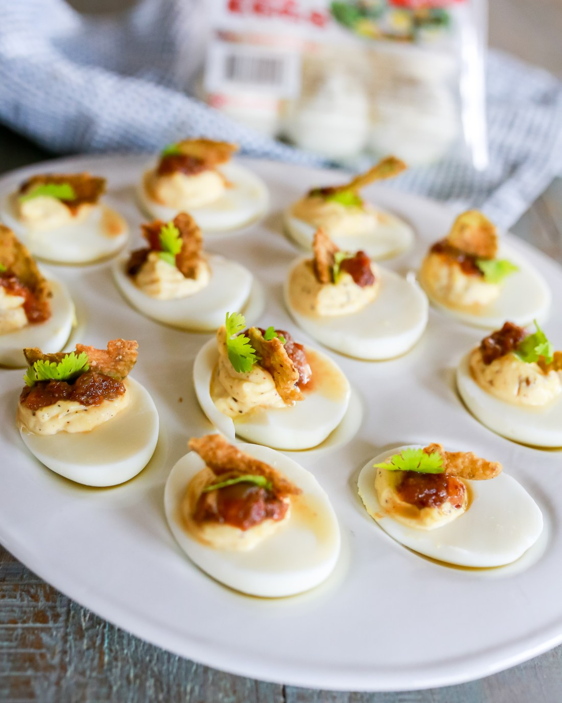 Five minute deviled eggs recipe. Deviled eggs  filled with a savory and creamy yolk and herbs mixture; then topped with crispy jalapeño and bacon jam.