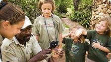 A guide teaches on an Exquisite Safari.