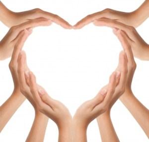 Ten hands forming a heart shape.