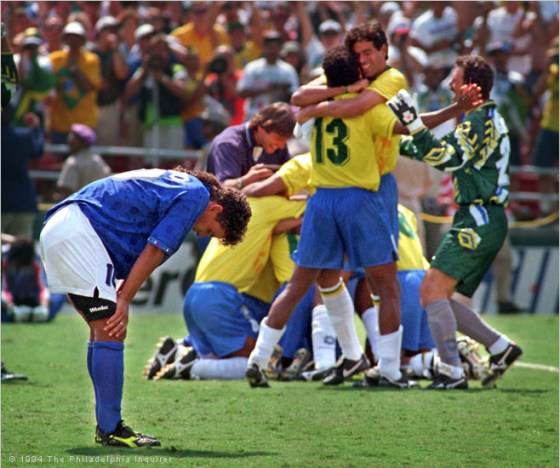 Roberto Baggio after missing a penalty kick. Brazil celebrates in the background.
