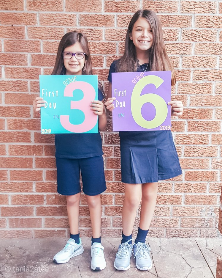 tania2atee-blog-first-day-of-grade-three-and-six-girls-outside-with-signs526923739.jpg