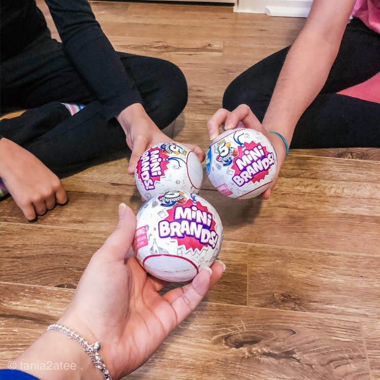 close up of hands holding surprise balls unopened