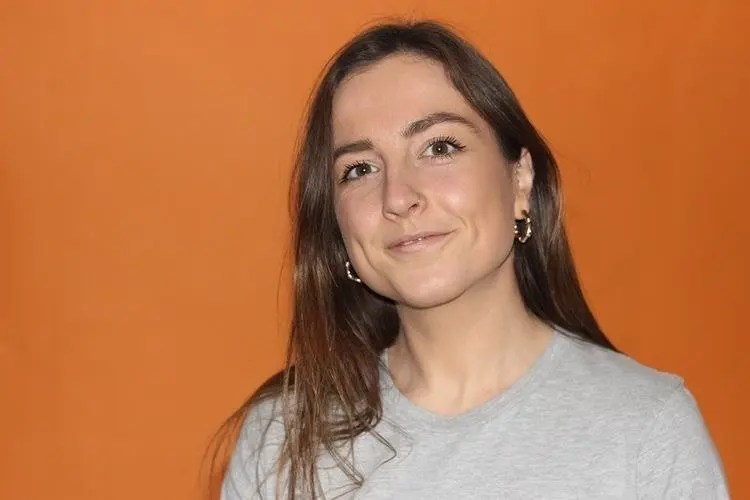 Vicki Hagger in front of an orange background
