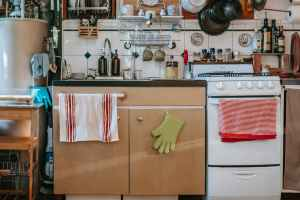 kitchen interior with gas stove and kitchenware in house