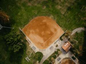 an overhead shot of an all dirt baseball field