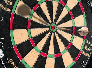a dart board with a dart in the bullseye