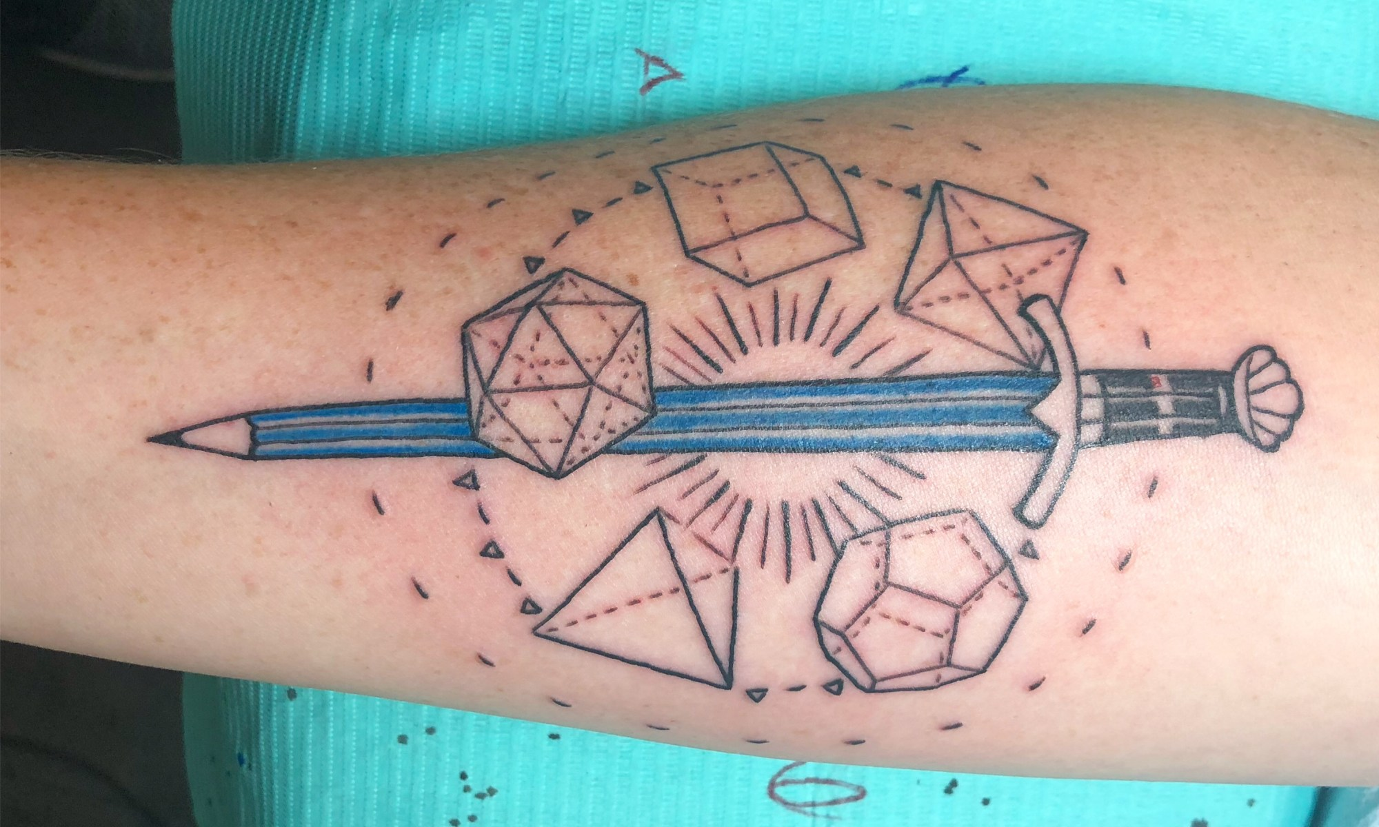 Tattoo of a sword-pencil surrounded by the platonic solids