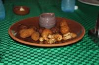 An assortment of fried cheese balls, minced beef and seasoned prawns