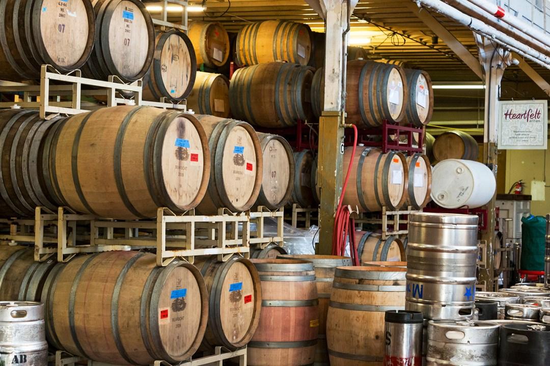 Stacks of wine barrels at winery
