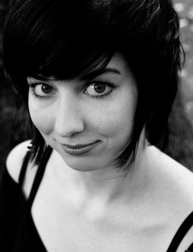 Black & white headshot of young woman with black hair