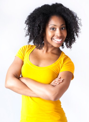 3/4 shot of woman with crossed arms and afro