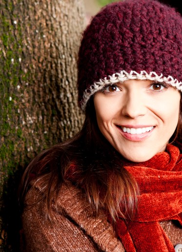 Outdoor headshot of smiling woman with tool hat