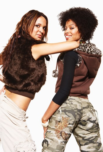 Two female hip hop dancers posing for camera