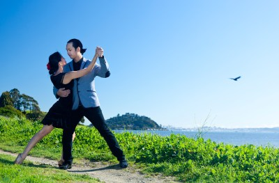 Couple posing in a tango pose outdoors in Tiburon
