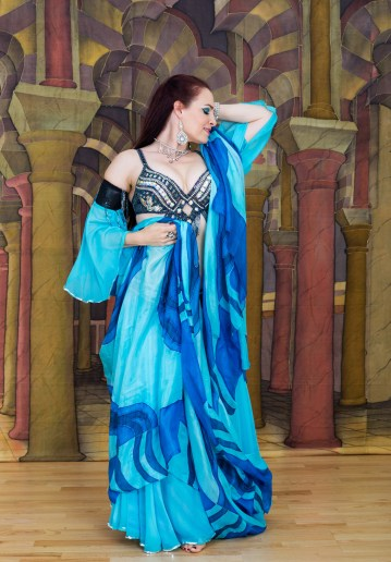 Female belly dancer with blue scarf standing
