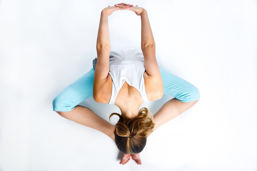 shot taken from above of woman doing yoga