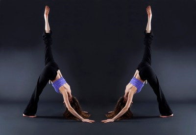 Mirror image of a woman extending one leg up