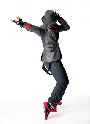 Male hip hop dancer standing on tip toes