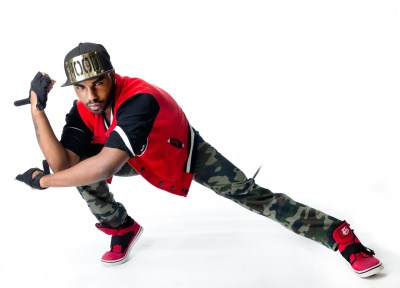 Male hip hop dancer posing in a low stance