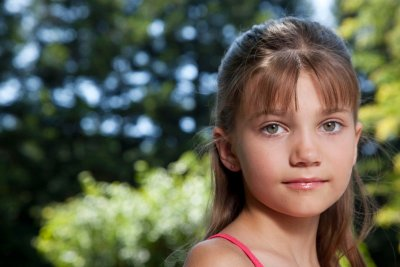 Portrait of little girl with bangs and long hair