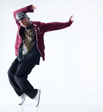 Male hip hop dancer standing on his toes