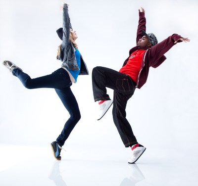 Couple of hip hop dancers dancing on one foot