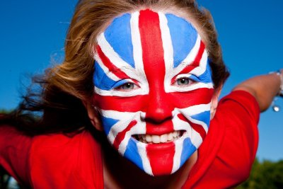 Close-up of blonde little girl with facepainting of British flag