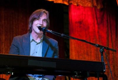 Jackson Browne playing and singing at the keyboards