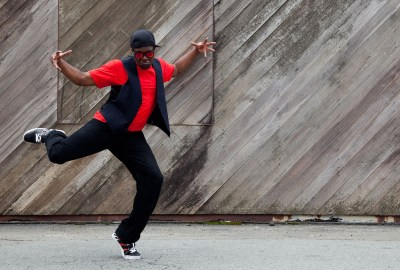 Fun expression of hip hop dancer posing in the street