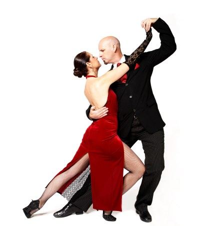 Couple dancing in the tango on white background