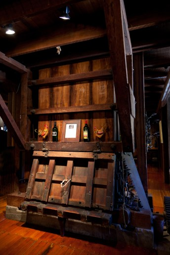 Antique wine wood distiller indoors at winery